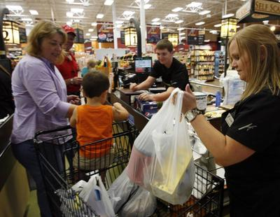 The quandary about using plastic or reusable shopping bags has a new wrinkle — reusable bags can make people sick if the bags are not kept clean. (This photograph is from Sept. 2011 and shows a family using the bags.) Ravell Call, Deseret News